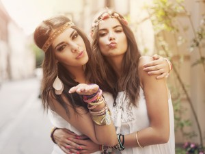 Beautiful boho girl blowing a kisses